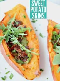 sweet potato skins on white plate topped with arugula