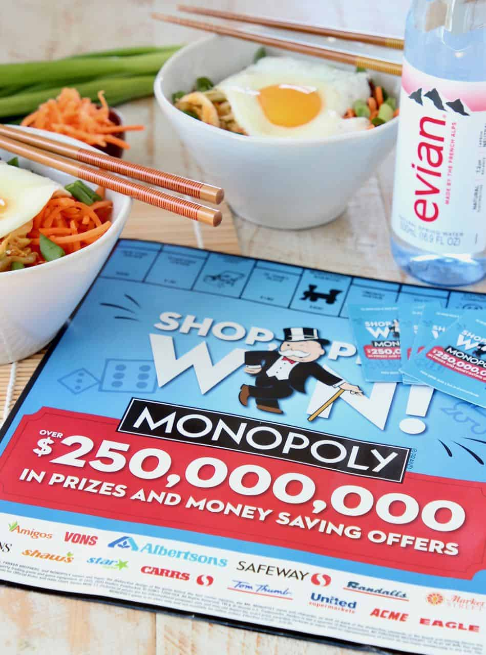 Monopoly game board with evian bottle water and rice bowls