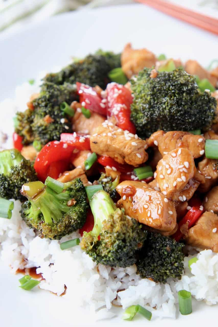 Teriyaki chicken pieces and broccoli over rice on plate