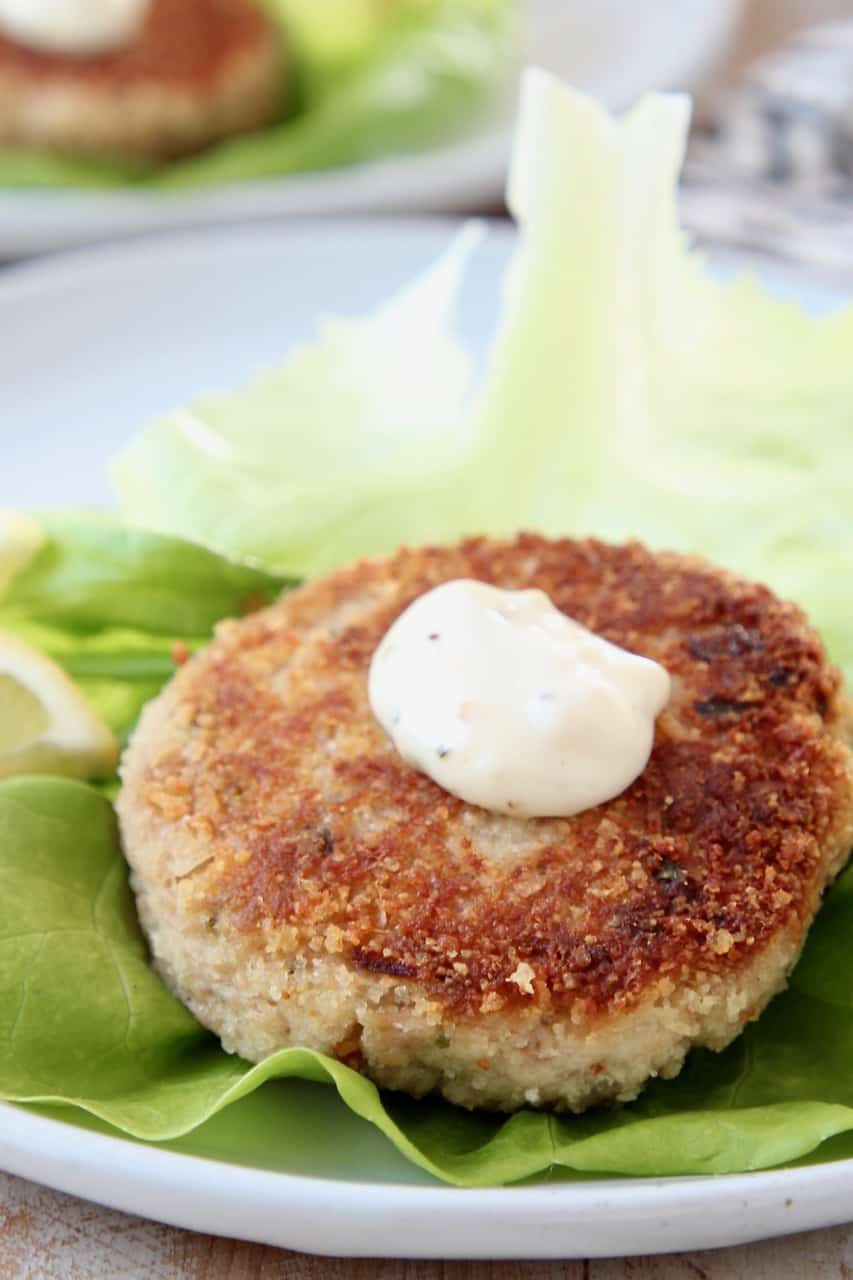 Crispy tuna cake on leaf of butter lettuce, topped with garlic aioli