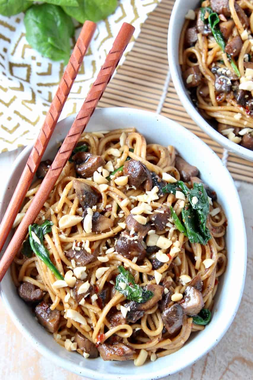 Overhead image of noodle dish in bowl with chopsticks on the side