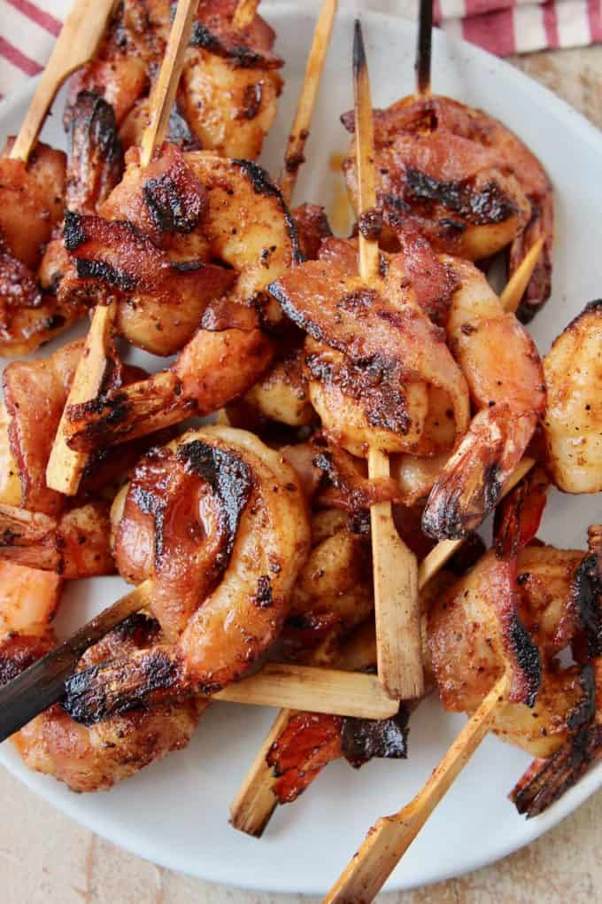 skewered bacon wrapped shrimp on plate