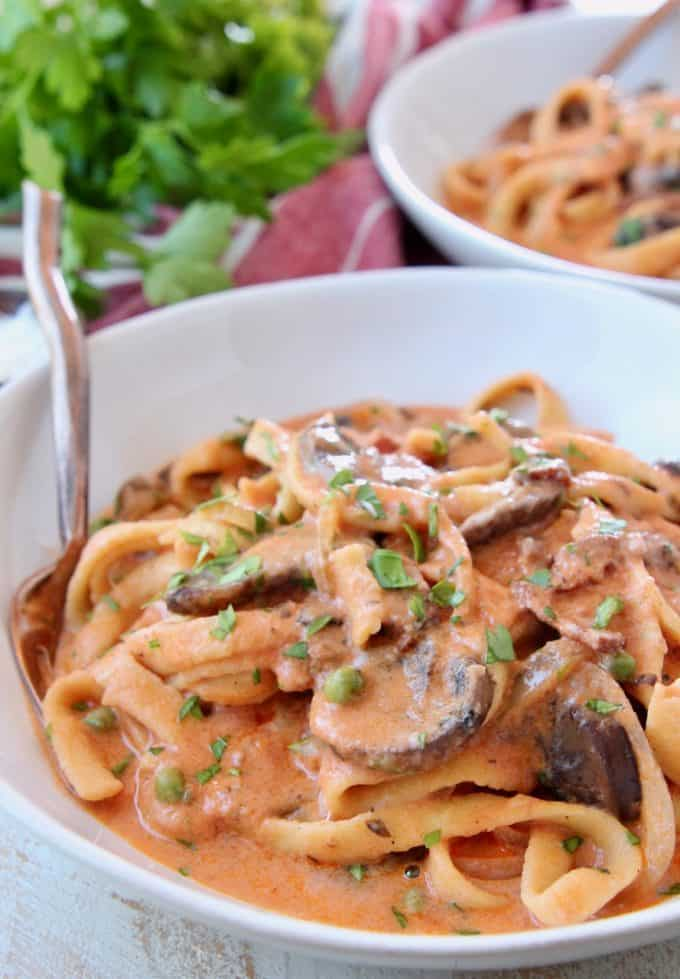 Creamy bosciaola sauce with pasta in bowl with fork