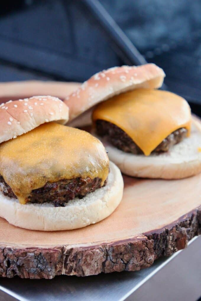 grilled cheeseburgers on wood cutting board