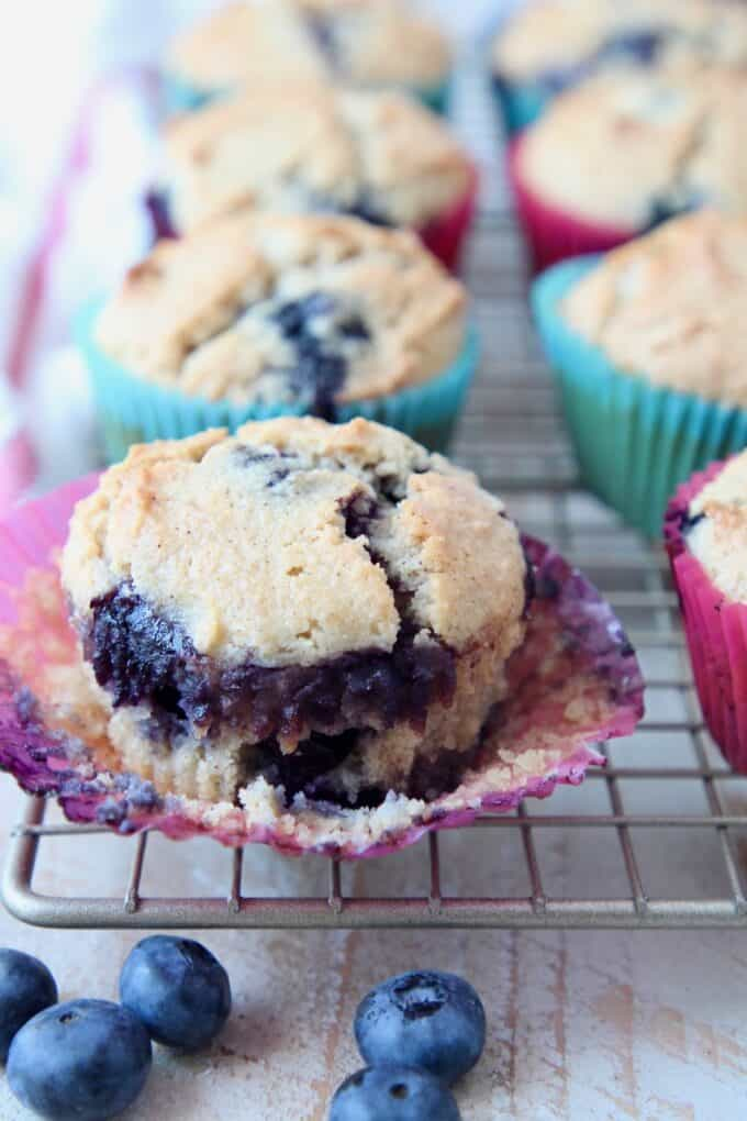 Blueberry muffin in paper liner on wire rack