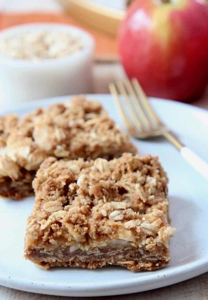 apple oatmeal bars on plate with fork