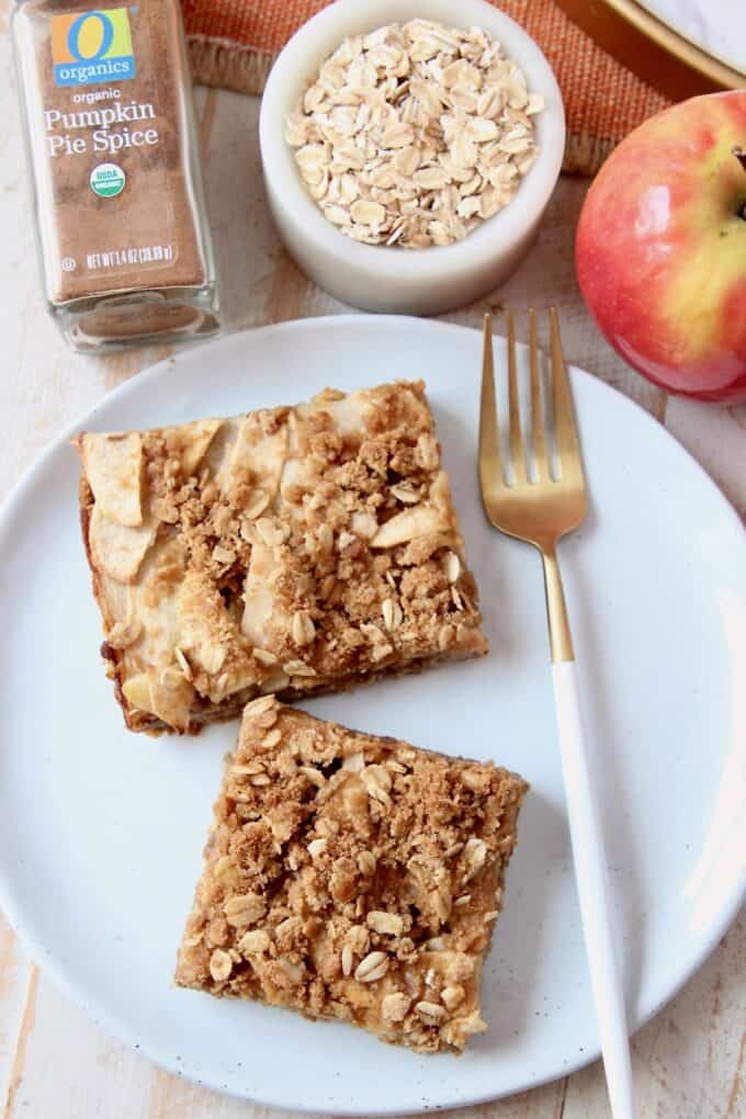 Overhead image of apple oatmeal bars on plate with spoon
