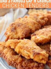 Stacks of fried chicken strips on plate
