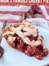 Slice of cherry pie on plate with fork