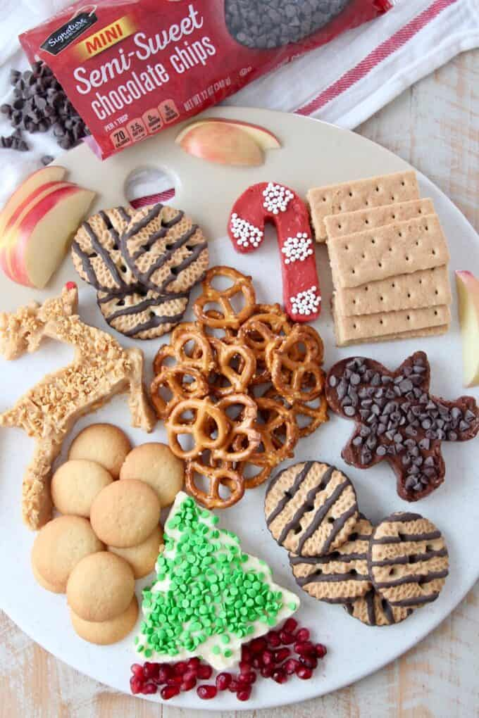 overhead image of holiday dessert board with chocolate chips on the side