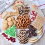 overhead image of holiday dessert board with cream cheese dips