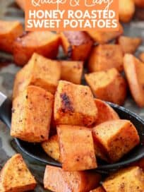 cubes of roasted sweet potatoes in serving spoon