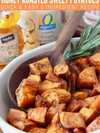 cubes of roasted sweet potatoes in bowl with serving spoon