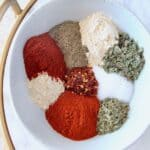 spices and herbs in white bowl