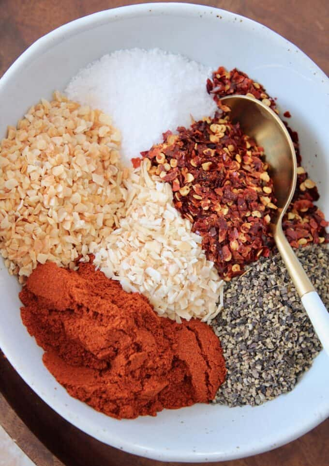overhead image of spices in bowl with spoon