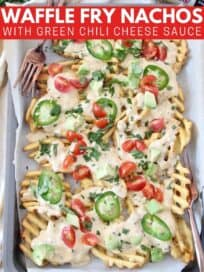 overhead image of waffle fry nachos on sheet pan with forks