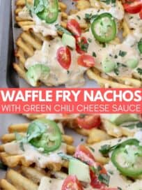 waffle fry nachos on baking sheet topped with cheese sauce and jalapenos