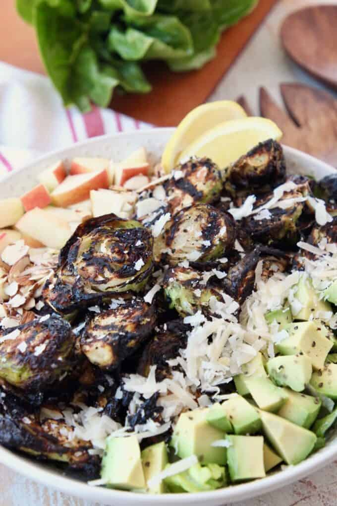 grilled brussels sprouts salad in bowl with diced avocado
