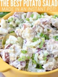 potato salad in bowl with spoon