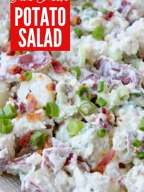 potato salad in bowl with bacon and green onions