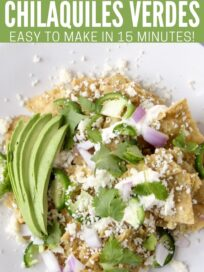 chilaquiles on plate topped with cilantro and avocado