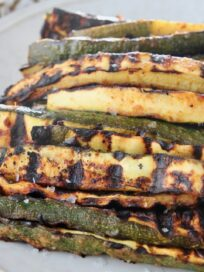 grilled zucchini spears on plate