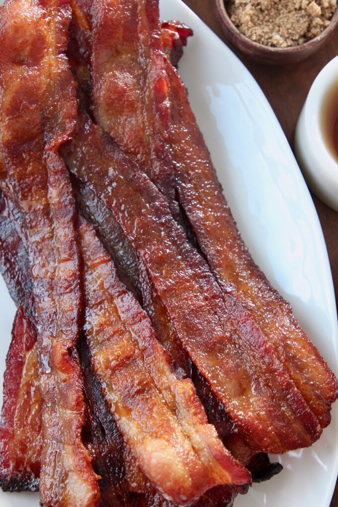 slices of cooked bacon on white plate