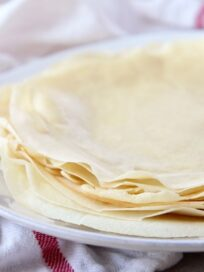 stack of crepes on white plate