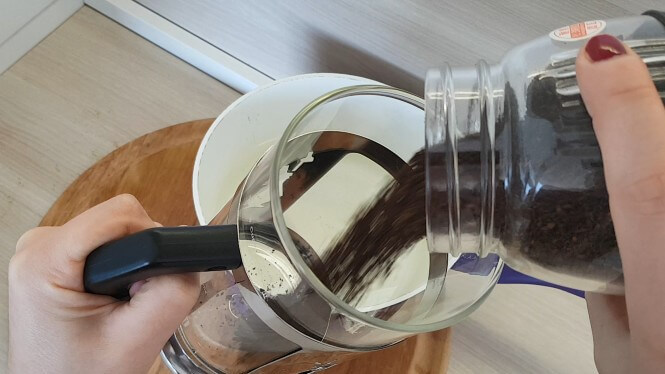 Step 1: Adding ground coffee to French press