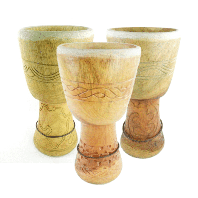 A selection of Ghanaian djembe shells with intricate carvings