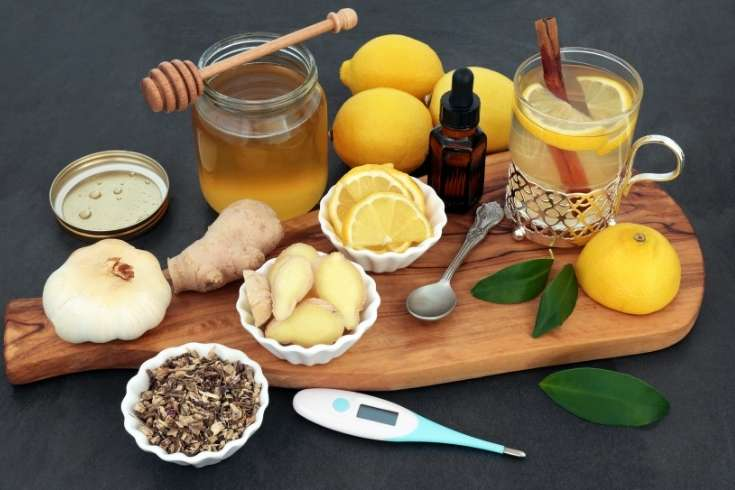 Cold and flu remedies. How to make natural remedies for colds and flu including a hot tea cold remedy drink, fire cider vinegar, immune boosting golden milk latte, elderberry syrup, elderberry tincture with herbs for cold and flu relief, and custom herbal tea blends for colds.