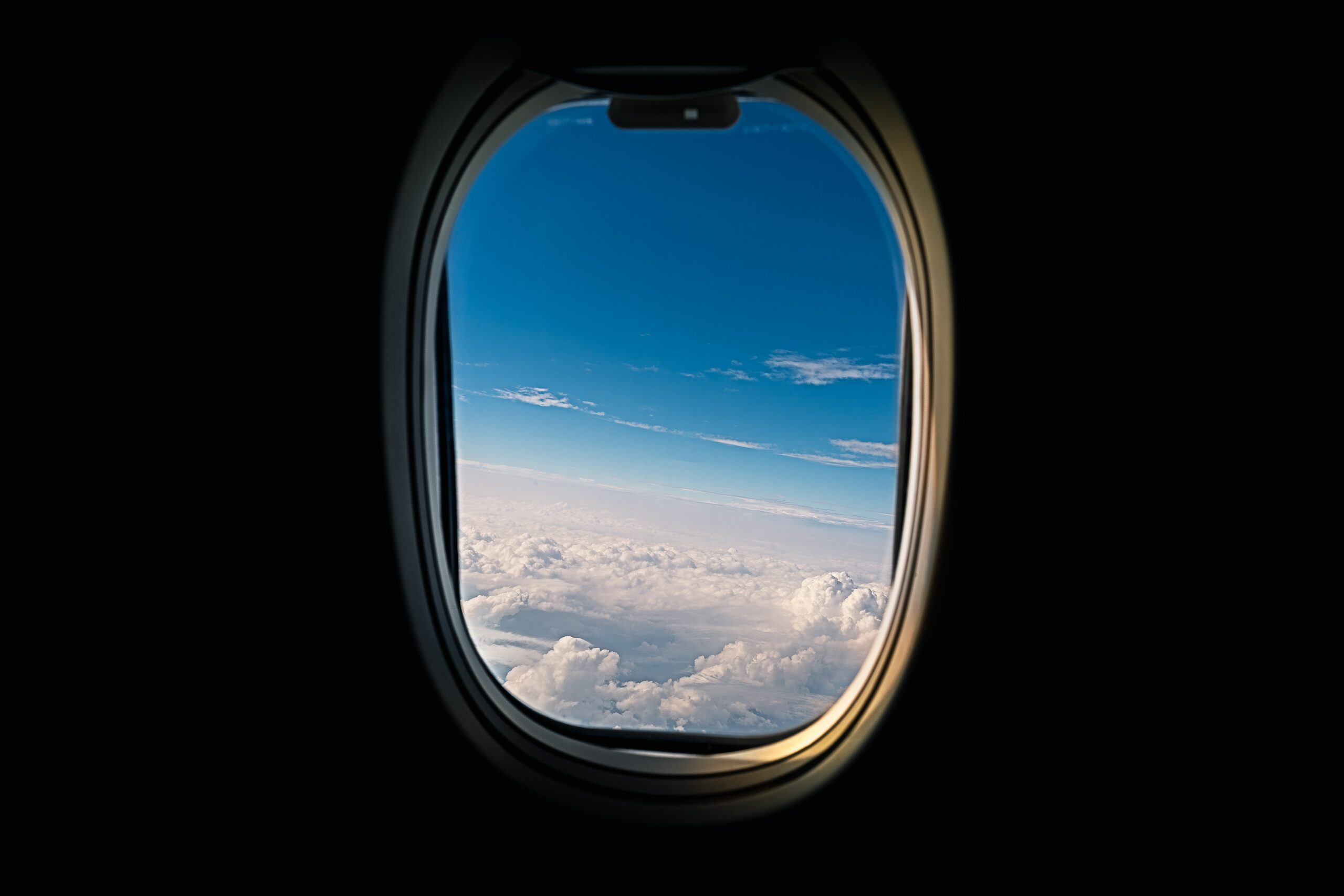 airline window viewing white clouds