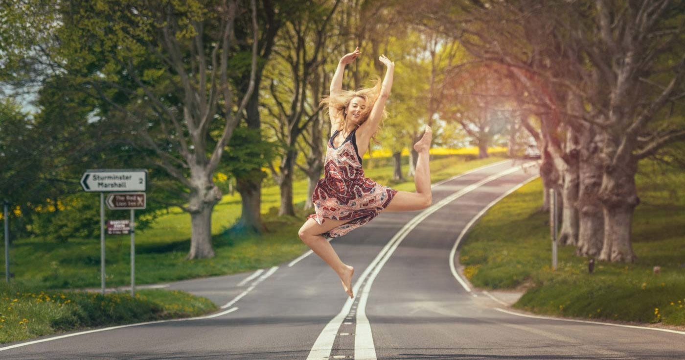 Woman dancing in the middle of the road