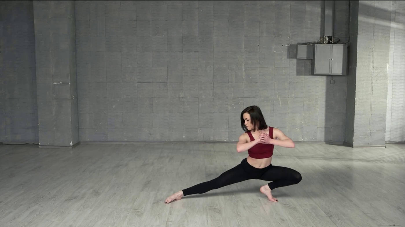 Girl stretching and warming up before the dance class