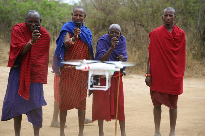 african tribesmen with drone