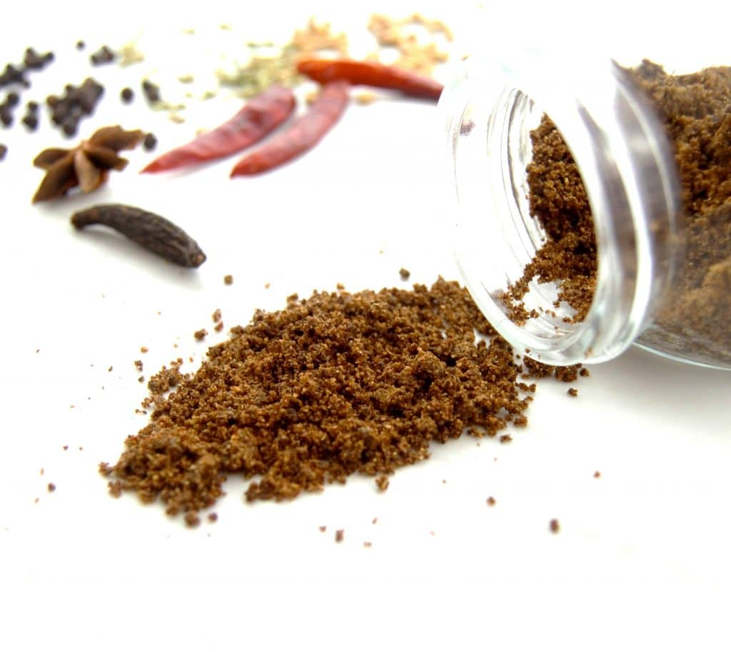 chettinad masala with spices on white table