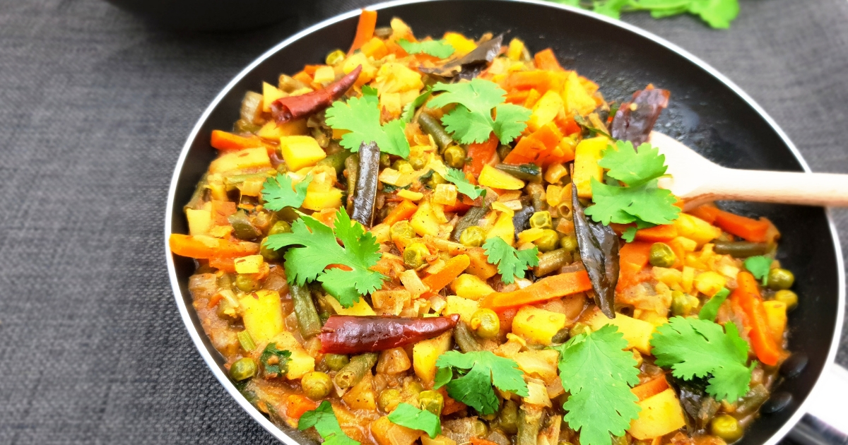 vegetable chettinad in a pan on dark grey background