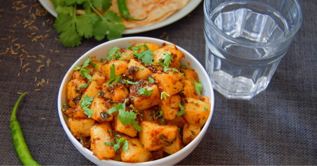 close up shot of jeera aloo