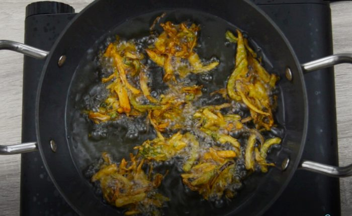 vegetable pakora frying in oil