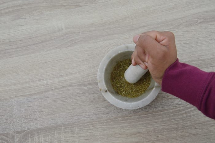 grinding spices in mortar and pestle.