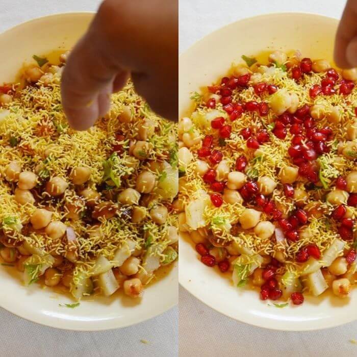 topping chana chaat with sev and pomegranate.