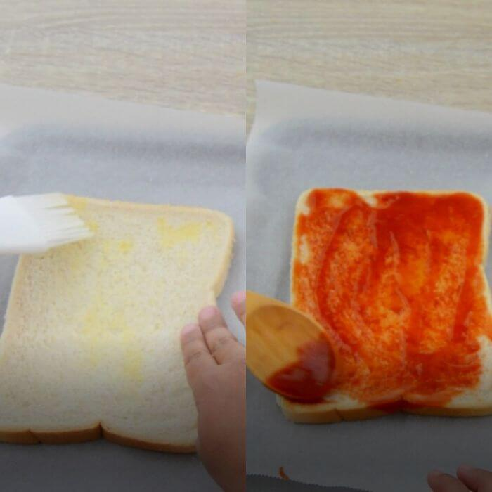 applying butter and tomato ketchup to bread slices.