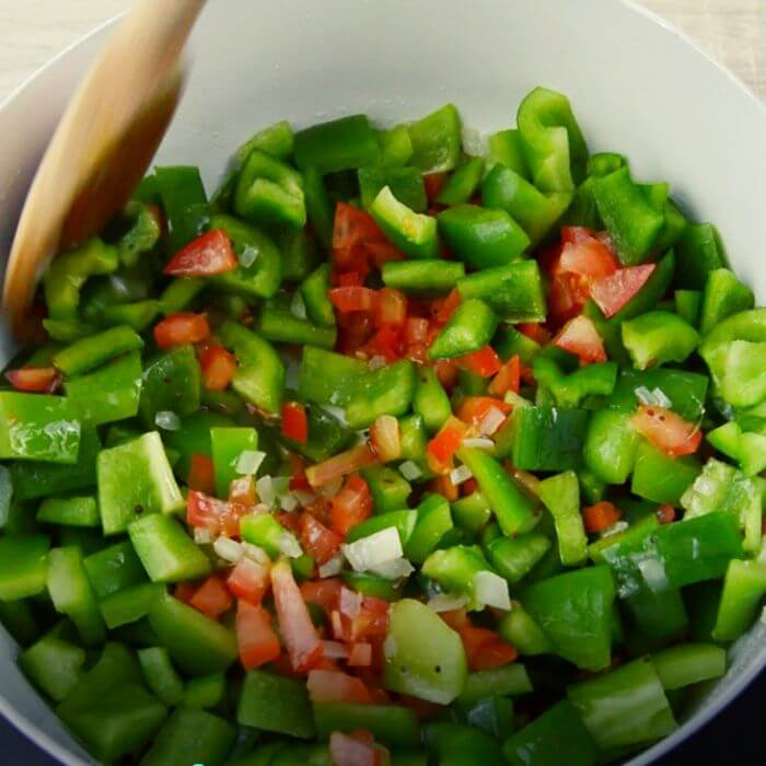 cooking capsicum and tomatoes.