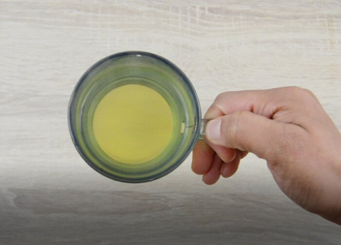 holding a cup of fresh mint tea.