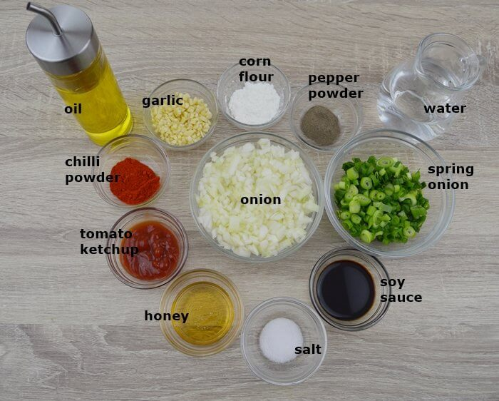 ingredients to make honey garlic sauce placed in individual bowls.