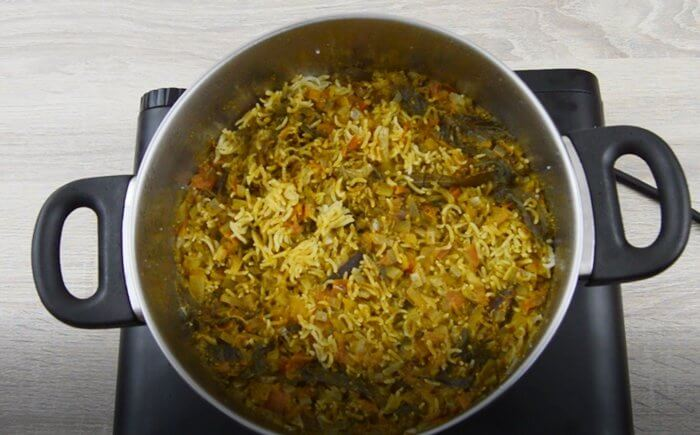 well cooked mint pulao in a steel pot.