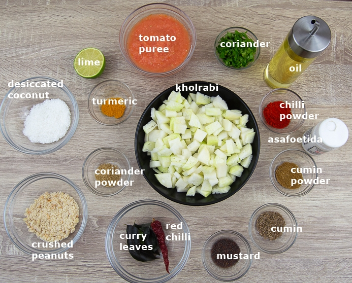 ingredients in an individual bowls placed on the table to make kohlrabi curry.