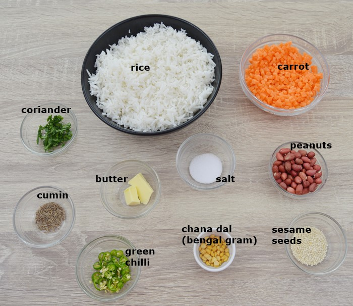 Ingredients to make carrot rice placed on a table.