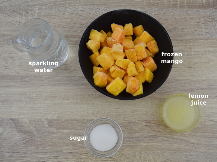 Ingredients placed on table to make mango lemonade.