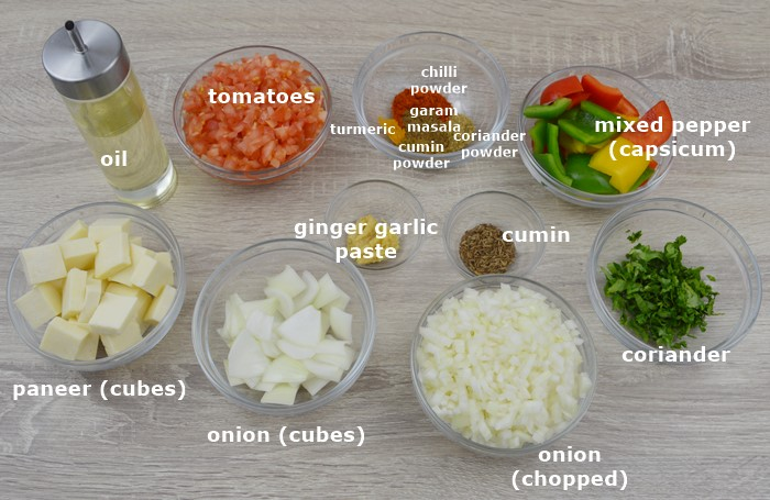 ingredients to make kadai paneer placed on a table.